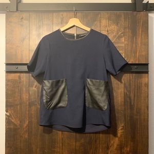Fun navy blouse with faux leather detail